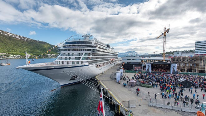A crowd gathers along the waterfront of Tromso, Norway on June 22, 2017 for the christening of Viking Ocean Cruises' newest ship, Viking Sky.