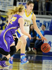 Riverside's Bree Linton attempts to dribble past Oliver Springs' Rachel Griffith during their TSSAA Class A quarterfinal game, Friday. The Lady Panters fell to the Lady Bobcats, 67-41.