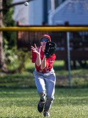 Conrad's Christopher Kramedas fields a fly ball in Conrad's 11-0 win over Newark Charter on Wednesday afternoon.