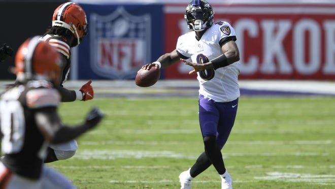 Baltimore Ravens quarterback Lamar Jackson (8) looks to pass, during the second half of an NFL football game against the Cleveland Browns, Sunday, Sept. 13, 2020, in Baltimore, MD.