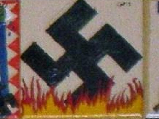 "A ""burning"" swastika in a memorial to the Holocaust at Pinelands Regional Junior High School in Little Egg Harbor."