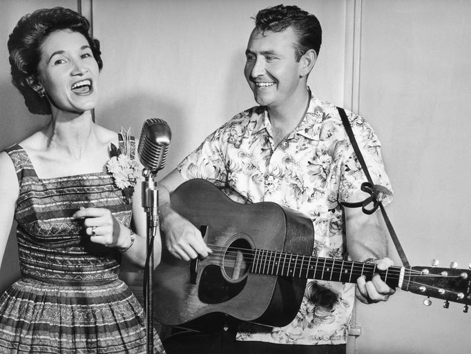 Two of the Grand Ole Opry's brightest new stars, Jan Howard, left, and Hank Cochran, prepare for a concert in Nashville on Aug. 12, 1960.