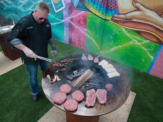Chef Rob Stoeckle tends to variety of meats while preparing a meal on the Artflame grill Thursday, Sept. 1, 2016, at Casa Figueroa in Pleasant Ridge.