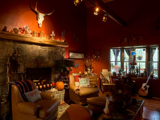 The living room of Jenna Jefferson and Keith Ford's home is warm and cozy.