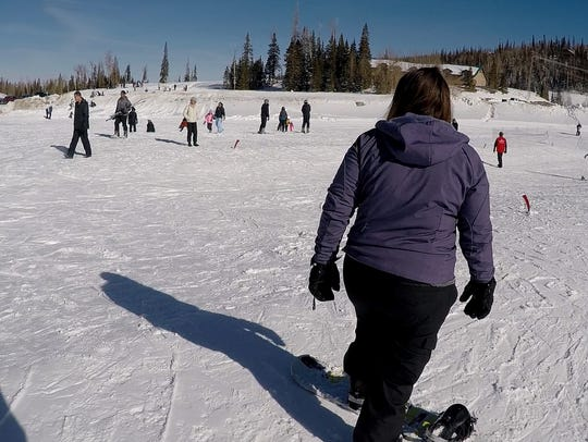 News reporter Emily Havens takes beginning snowboarding