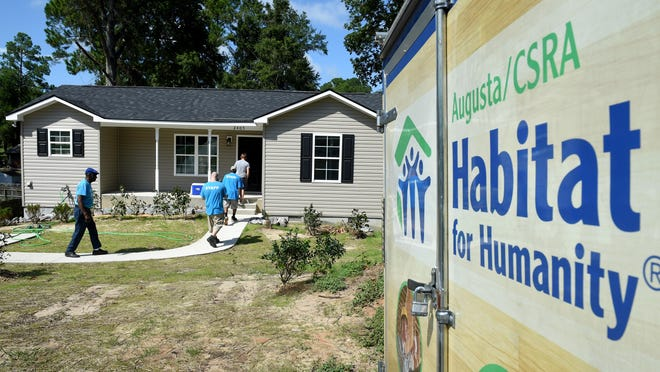 FILE - Kesha Michelle Brooks' new home just before the start of the Habitat for Humanity home dedication ceremony in Augusta, Ga. Wednesday afternoon August 28, 2019.