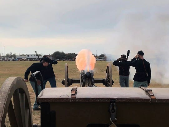 Re-enactors fire their cannon Saturday, Dec. 2, 2017,