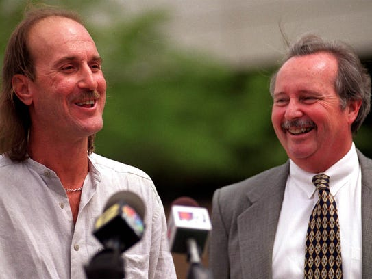 Ray Krone, left, and his attorney Alan Simpson talk