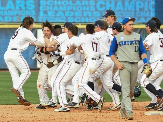 Auburn teammates mob freshman Edouard Julien in celebration
