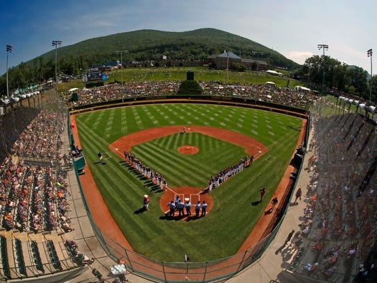 Fairfield, Conn., lines the third baseline and Jackson,