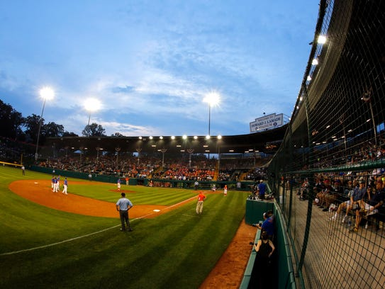 The sunsets on Lamade Stadium during a baseball game