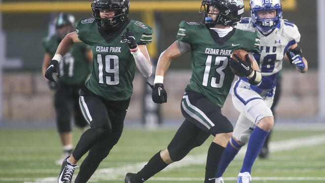 Cedar Park receiver Gunnar Abseck, right, races away from the Georgetown defense while escorted by teammate Jack Hestera in the first half of the Timberwolves' 56-24 win over Georgetown on Friday at Gupton Stadium in Cedar Park.