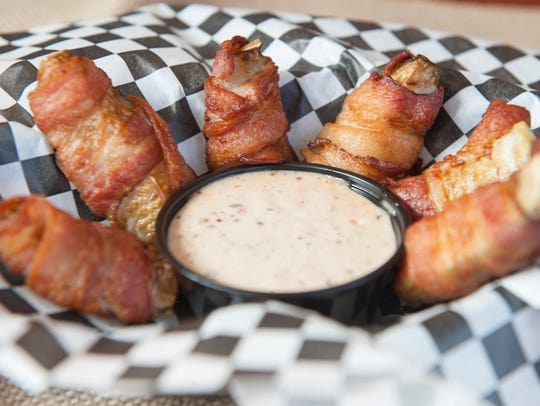 Bacon wrapped fried pickles with remoulade sauce are