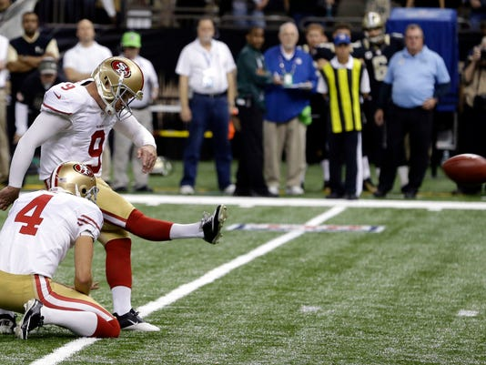 San Francisco 49ers kicker Phil Dawson (9) boots an NFL football game-winning field goal in overtime against the New Orleans Saints in New Orleans, Sunday, Nov. 9, 2014. The 49ers won 27-24. (AP Photo/Jonathan Bachman)