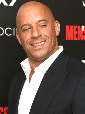 """Vin Diesel attends The Cinema Society with Men's Fitness and FIJI Water special screening of Marvel's """"Guardians of the Galaxy"""" at Crosby Street Hotel on July 29, 2014 in New York City."""
