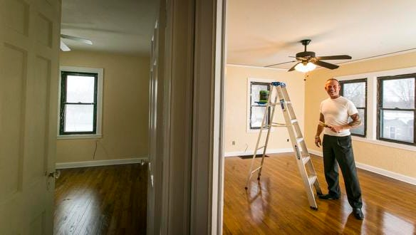 John Eddleman, a first-time homebuyer, works on his house in Des Moines.  Eddleman bought his house in January using a 3% down payment.