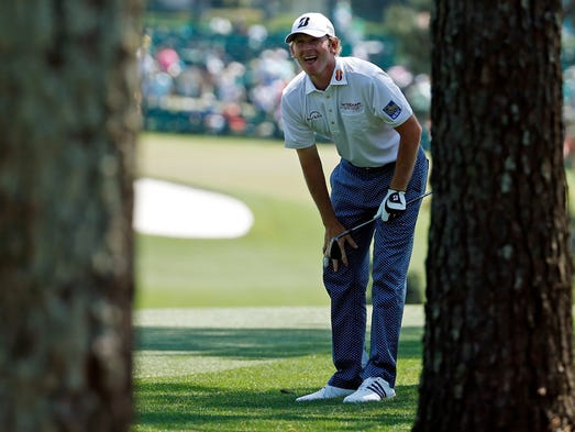 Brandt Snedeker looks for his shot out of the rough on the first fairway during the third round of the Masters golf tournament Saturday, April 12, 2014, in Augusta, Ga.