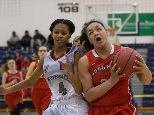 Bound Brook's Janee'a Summers drives to the basket past University's Halley Aquilar in first half action. Bound Brook vs University in Public Group 1 Girls Basketball Final in Toms River NJ, on March 12, 2017.
