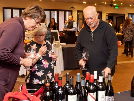 Guests sample wines at the 2017 Fort Collins Wine Fest.