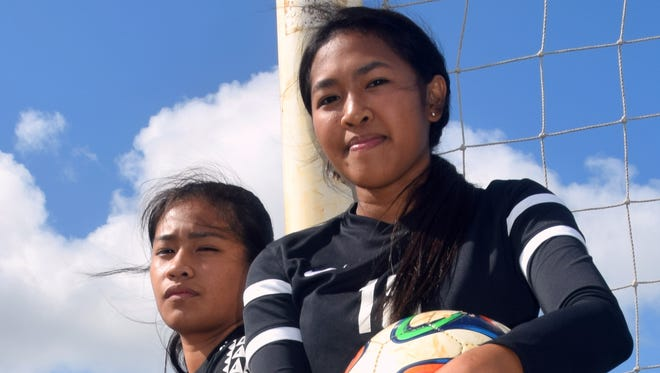 Caylani Estoy (left) and Faith Tesei will be transitioning from highlight performances in rugby and softball. The duo hope to help the Simon Sanchez Sharks' girls soccer team defend its 2015 IIAAG title.