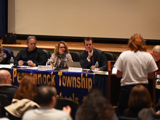 The Pequannock Board of Education and  Superintendent Brett Charleston listen as a resident asks a question about reconfiguring the district's elementary schools during a Board of Education meeting at Pequannock Township High School in Pequannock on March 27th, 21017.