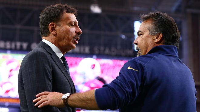 It looks increasingly likely that owner Stan Kroenke (left) will move coach Jeff Fisher and the Rams to Los Angeles.