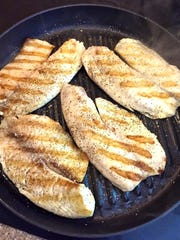 To grill your fish inside, heat a grill pan that has been lightly brushed with olive oil over medium-high heat.