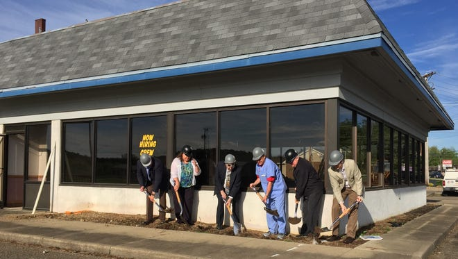Andy Smallstey, Jodie Perry, Gene Parkison, Rock Webster, Bob Neumann and Barrett Thomas took part in a groundbreaking ceremony Monday in Lexington. The former Hardee's restaurant building, located at the corner of State Route 42 and State Route 97, will be the site of Heartland Academy, a new school for students with autism.