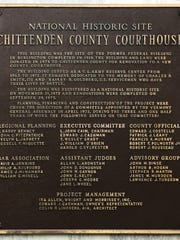 Plaque outside the current courthouse lists members