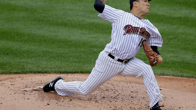 Masahiro Tanaka, playing for the Triple A Scranton/Wilkes Barre RailRiders, delivers against the Durham Bulls during the second inning. Tanaka threw 41 pitches and gave up two hits in his first rehab start after missing almost a month with wrist tendinitis and a mild forearm strain.