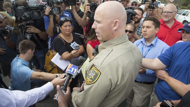 Pinal County Sheriff Paul Babeu, who is seeking a seat in Congress, talks to the media in 2014.