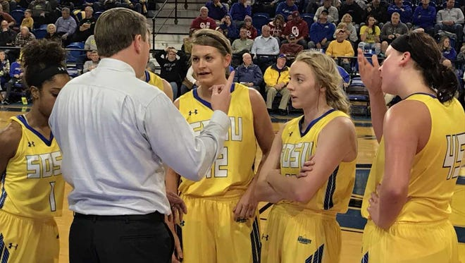 SDSU coach Aaron Johnston instructs his players during a break in the action Wednesday night at Frost Arena.