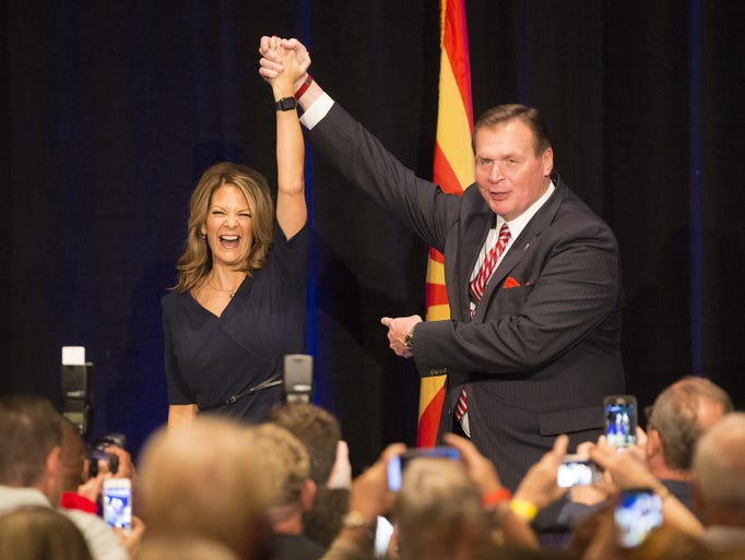 Former U.S. Rep. J.D. Hayworth, R-Ariz., (right) holds