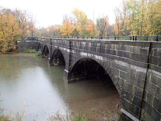 Eighteen aqueducts were built when the Erie Canal had to cross a river or ravine. This one has been rebuilt and is operational. It is in the town of Camillus at Nine Mile Creek, west of Syracuse, N.Y. Using the original limestone supports, a trunk or trough to hold the water was rebuilt with heavy wooden beams glued together, much like the construction of the c. 1838-1841 aqueduct.