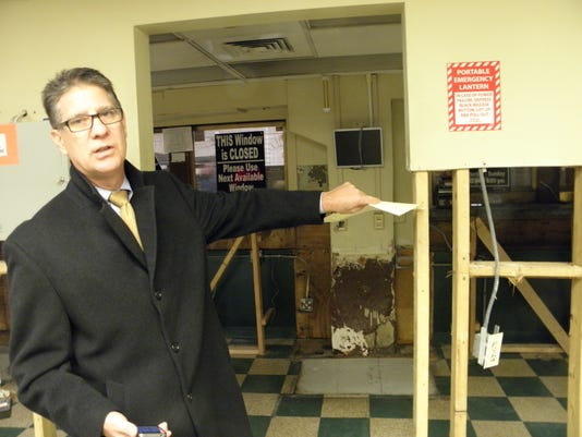 Meade shows high water mark in ticket office.jpg