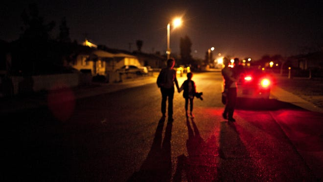 CPS caseworkers work with Phoenix police while taking custody of children.