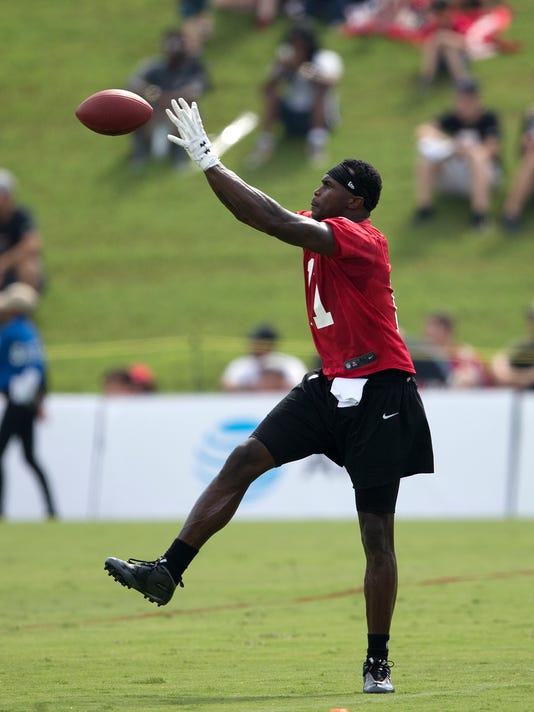 Atlanta Falcons wide receiver Julio Jones (11) catches a pass during NFL football training camp Friday, July 28, 2017, in Flowery Branch, Ga. (AP Photo/John Bazemore)