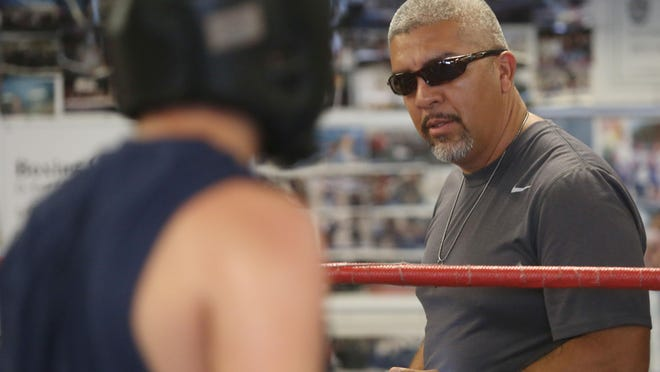 Trainer Joel Diaz oversees a sparring session on Wednesday at the Indio Boys & Girls Club. Diaz was let go by WBO welterweight champion Timothy Bradley Jr. after a long career together.