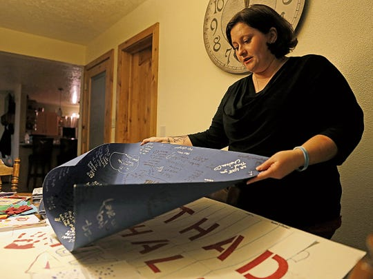 Amber Hale shows posters, letters and cards on March 25, 2015, that were sent to the family after her son, Thaddeus, took his own life in November 2014.