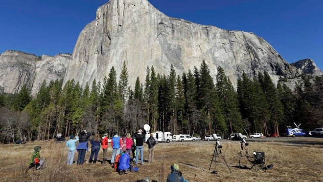 Spectators gaze at El Capitan for a glimpse of climbers Tommy Caldwell and Kevin Jorgeson on Jan. 14.