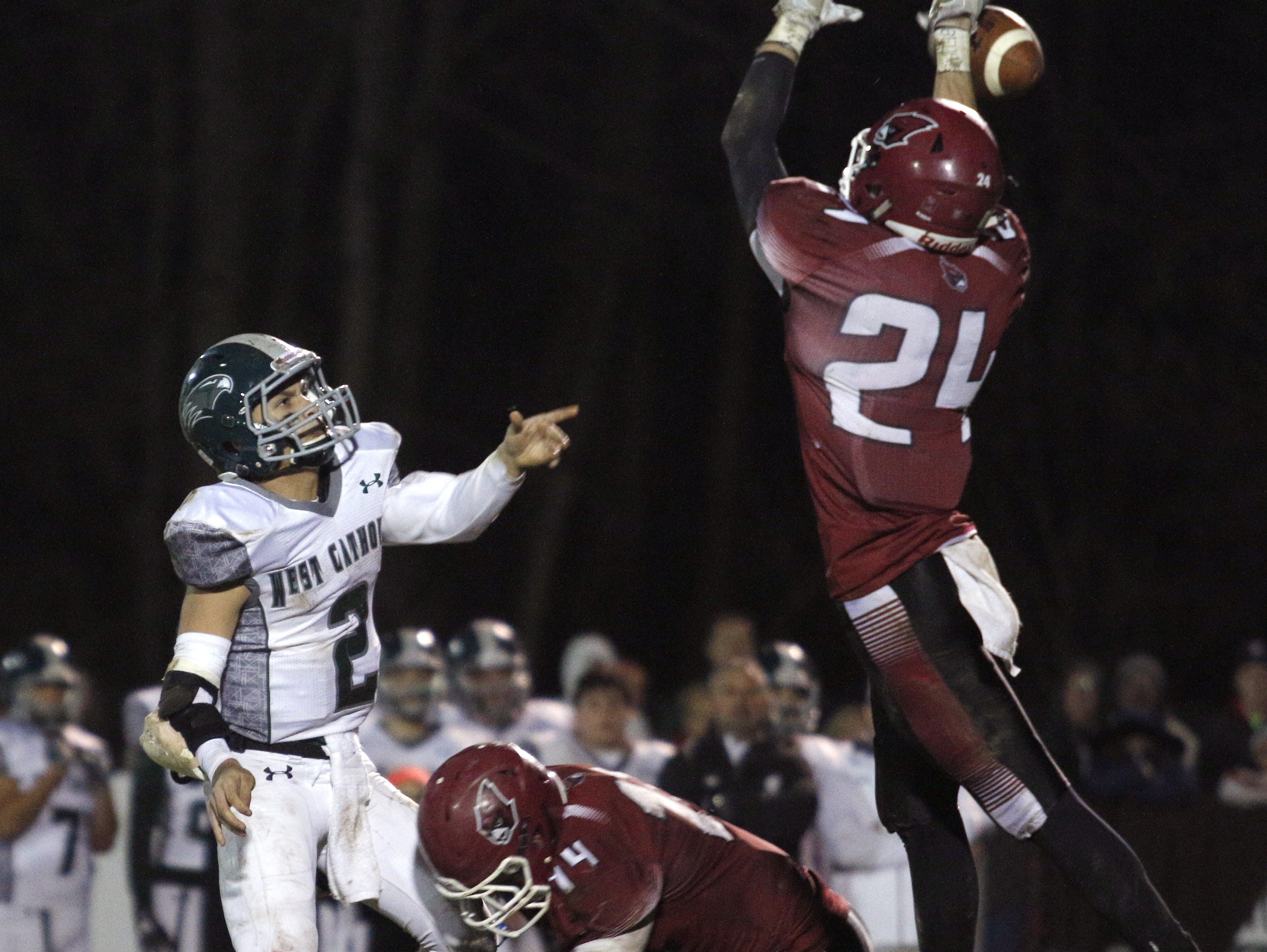 Portland's Treyvin Groesser, right, bats down a Grand Rapids West Catholic pass by Gaetano Vallone, during a playoff game earlier this month. Groesser is an Associated Press Division 5-6 all-state selection,