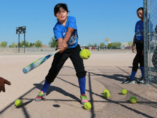 Amber Hernandez of the Cubs practices her swing.