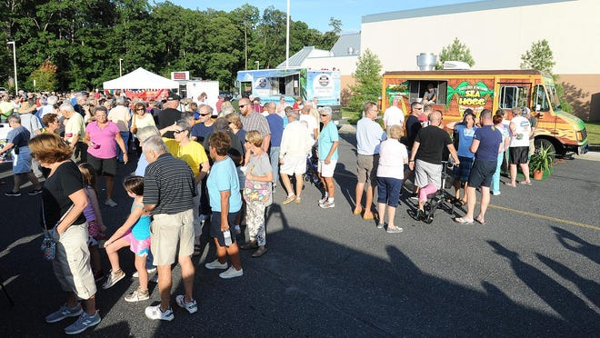 A large crowd was on hand to try the crab cakes, Jewish deli sandwiches, tacos and other goodies offered at the inaugural Food Truck Fridays event in Rehoboth Beach.