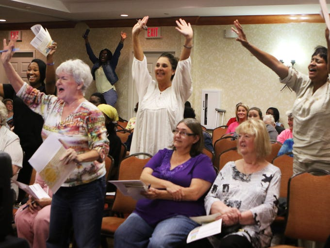 Audience members at an Extreme Couponing workshop led