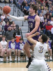 Lexington's Ben Vore attempts a jump shot during a sectional game against Vermilion at Madison on Tuesday.
