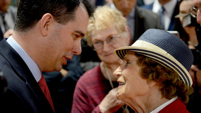 Wisconsin Governor Scott Walker smiles Monday as he shakes hands with former longtime Lansing Councilwoman Alfreda Schmidt at the R.E. Olds Transportation Museum in Lansing after he spoke at a lunch hosted by the Ingham County Republican Party. Walker, a likely candidate for the Republican nomination for president, spoke on the economy, international relations and more.