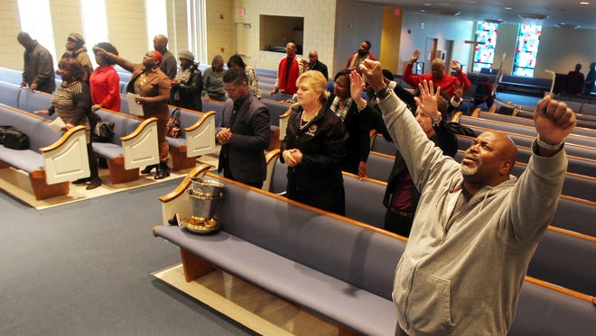Pastor Jerry Culbreth, of Tryed  Stone New Beginnings Church, Bond Hill, and others pray to end teen suicide during a meeting and prayer service at Church of the Living God, Avondale.