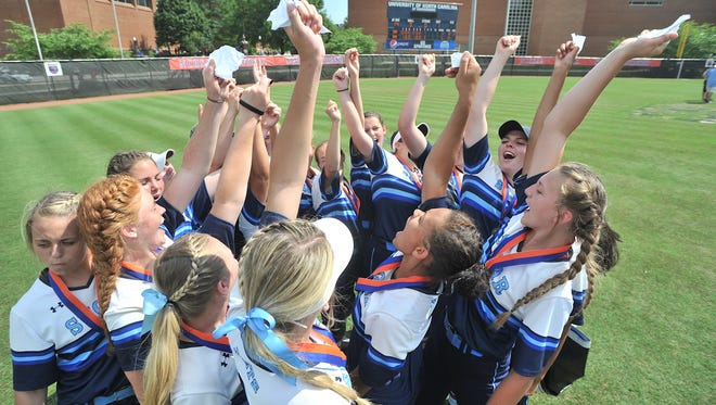 Enka softball players celebrate after repeating as the NCHSAA 3-A softball champions on Saturday in Greensboro.