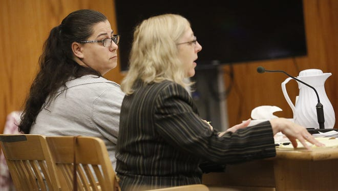 Tina Ewell sits with her attorney Dawn Sabel Oct. 25 in a Fond du Lac County courtroom during her trial.