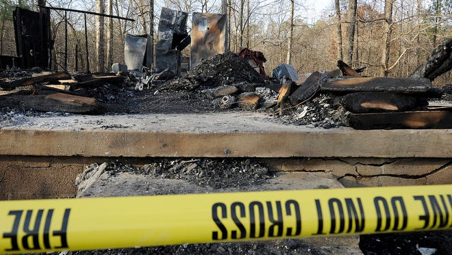 The remains of a burned-out house are seen along Bemis Cemetery Road in Jackson, Tenn., on Jan. 9, 2017.